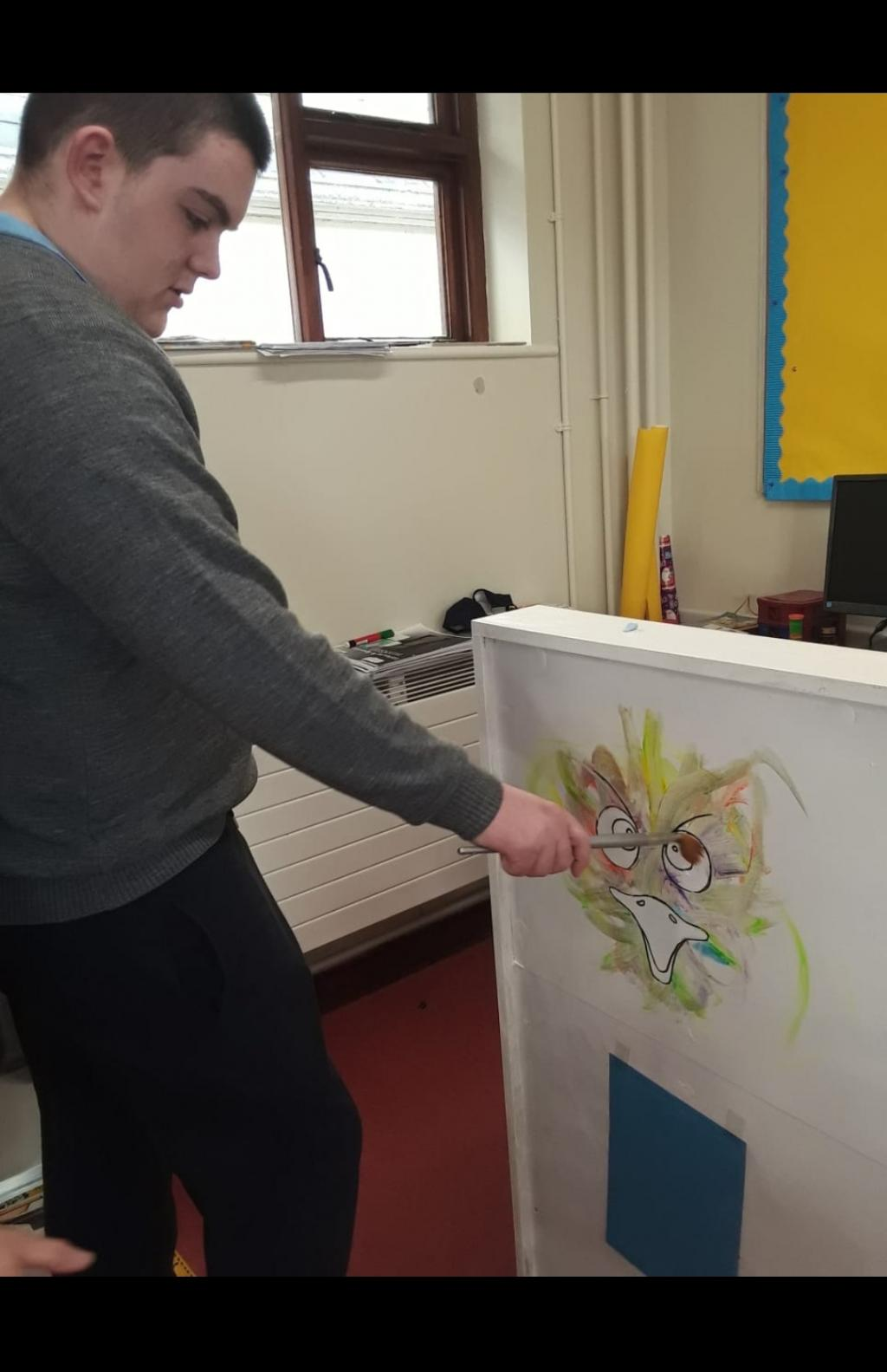 Art Students working on mural for art exhibition in January.